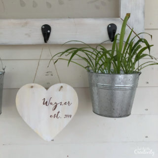 This is a creative and budget friendly way to add farmhouse style to your valentines decor, using a wood heart from Dollar Tree