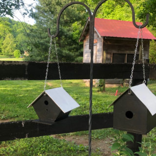 Two thrift store birdhouses get a makeover into lovely black and white Farmhouse style birdhouses